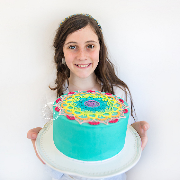 Liana-holding-mandala-cake